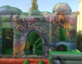 Inflatable bouncy castle play area with dinosaur theme