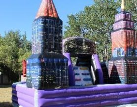 Inflatable bouncy castle play area with King Kong city scape them
