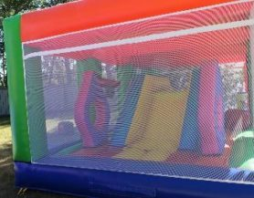 Enclosed bouncy castle with slide